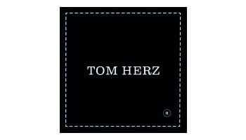 TOM HERZ Logo